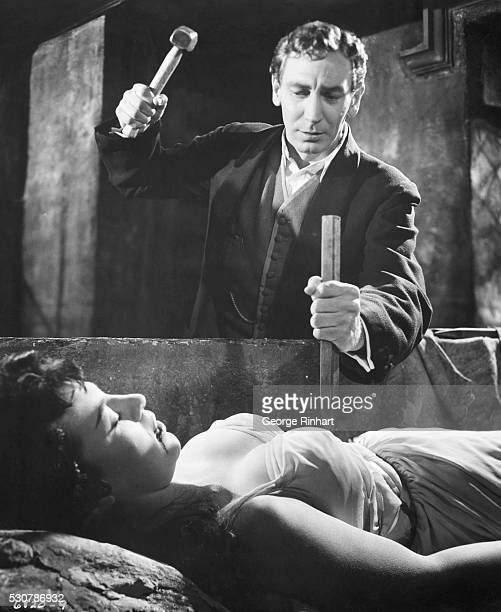 1958 John van Eyssen prepares to drive a wooden stake through the heart of vampire Valerie Gaunt to free her from the evil spell into which she has...