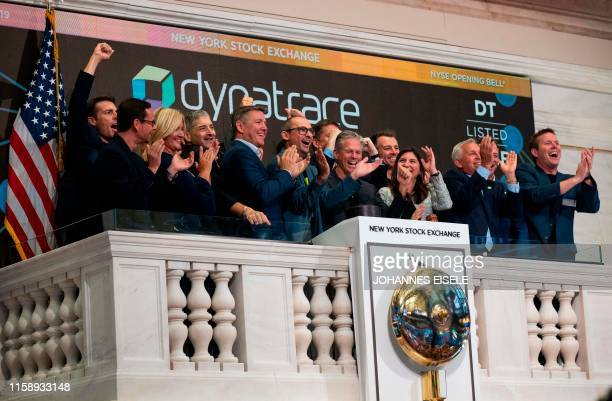 John Van Siclen , Chief Executive Officer of Dynatrace, surrounded by employees, rings the opening bell during his company's IPO at the New York...