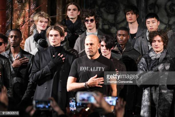 John Varvatos during the national anthem stands with models wearing John Varvatos Fall/Winter 2018 with makeup by Chika Chan for MakeUp Pro and Hair...