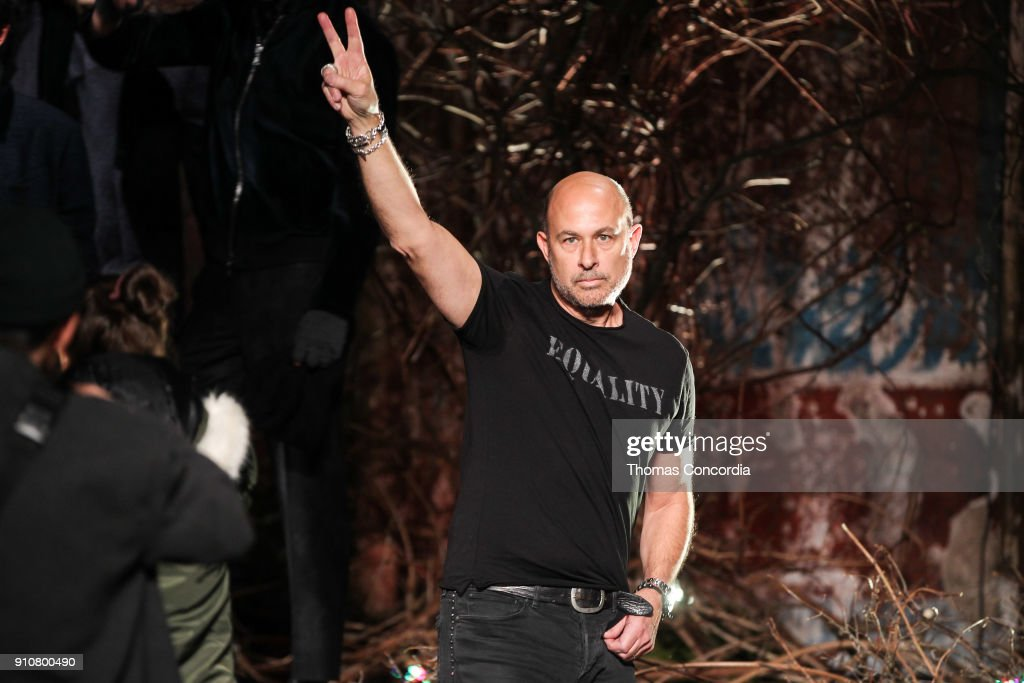 John Varvatos, gives a peace sign after presenting the John Varvatos Fall/Winter 2018 collection with makeup by Chika Chan for Make-Up Pro and Hair by Yannik D'Is for Cultler/Redken at the Angel Orensanz Foundation on January 26, 2018 in New York City.