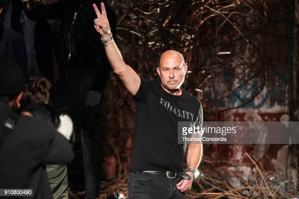 John Varvatos gives a peace sign after presenting the John Varvatos Fall/Winter 2018 collection with makeup by Chika Chan for MakeUp Pro and Hair by...