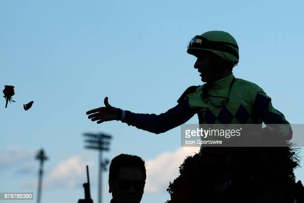John Velazquez celebrates with a rose after winning the Kentucky Derby aboard Always Dreaming on Kentucky Derby Day at Churchill Downs on May 6 2017...