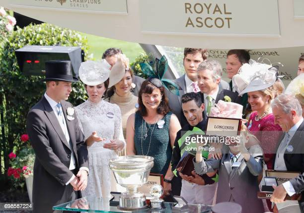 John Velazquez holds the King's Stand Stakes trophy with trainer Wesley Ward as Catherine Duchess of Cambridge and Prince William Duke of Cambridge...