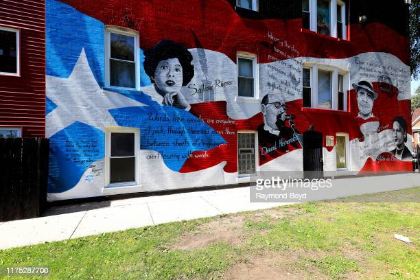 John Vergara John Pitman Weber Patricia Perez Alisa Scott and YSVP youth volunteers Jacob Jimenez and Jelani Davis' u2018Legendsu2019 mural honors...