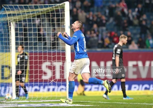 John Verhoek of Hansa Rostock celebrates after scoring during the 3 Liga match between Hansa Rostock and Eintracht Braunschweig at Ostseestadion on...