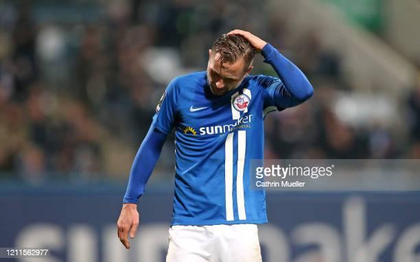 John Verhoek of Hansa Rostock reacts during the 3 Liga match between Hansa Rostock and Eintracht Braunschweig at Ostseestadion on March 09 2020 in...