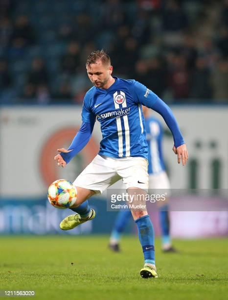John Verhoek of Hansa Rostock runs with the ball during the 3 Liga match between Hansa Rostock and Eintracht Braunschweig at Ostseestadion on March...