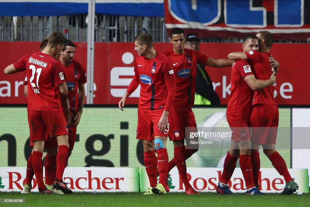 John Verhoek (2R) of Heidenheim celebrates his team's second goal with team mates during the Second Bundesliga match between SV Sandhausen and 1. FC Heidenheim 1846 at BWT-Stadion am Hardtwald on November 24, 2017 in Sandhausen, Germany.
