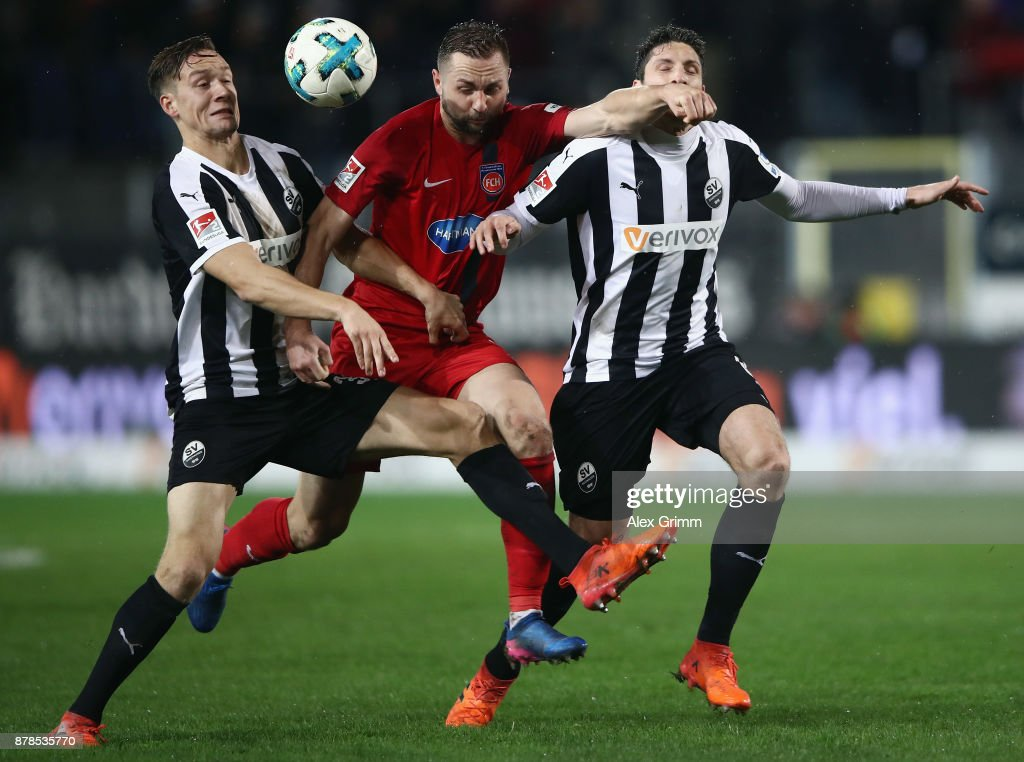 John Verhoek (L) of Heidenheim is challenged by Tim Knipping (L) and Tim Kister of Sandhausenduring the Second Bundesliga match between SV Sandhausen and 1. FC Heidenheim 1846 at BWT-Stadion am Hardtwald on November 24, 2017 in Sandhausen, Germany.