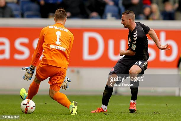 John Verhoek of St Pauli scores the second goal against Michael Ratajczak of Duisburg during the 2 Bundesliga match between MSV Duisburg and FC St...