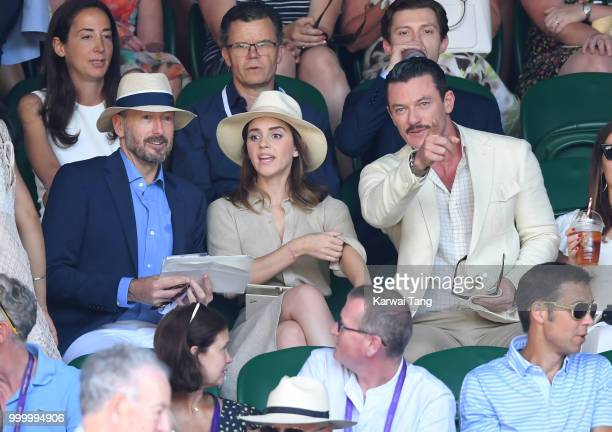 John Vosler Emma Watson and Luke Evans attend the men's single final on day thirteen of the Wimbledon Tennis Championships at the All England Lawn...