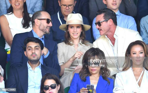 John Vosler Emma Watson and Luke Evans attend the men's singles final on day thirteen of the Wimbledon Tennis Championships at the All England Lawn...