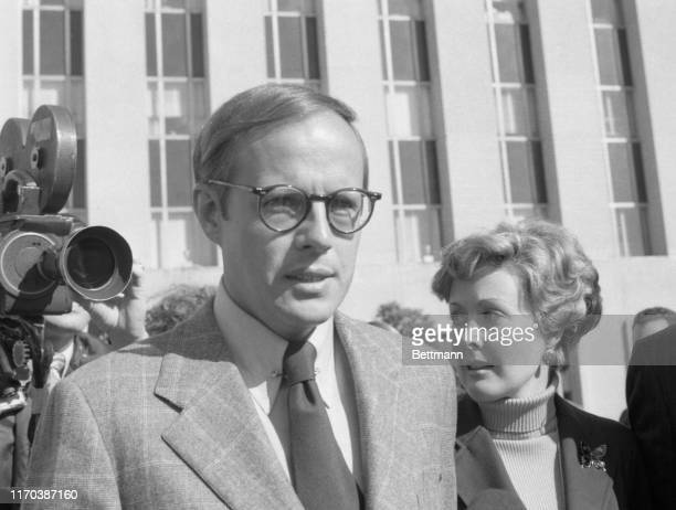 John W Dean III and his wife Maureen leave US District Court after Dean President Nixon's former legal counsel pleaded guilty to conspiracy in...