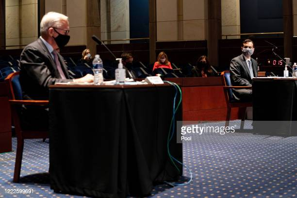 John W Elias a prosecutor in the Justice Department's antitrust division and former Deputy Attorney General Donald Ayer testify at a hearing of the...