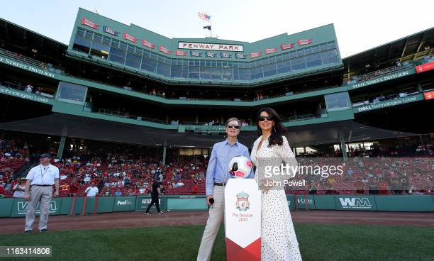 John W Henry owner of Liverpool and Linda Pizzuti Henry a Pre-Season Friendly match between Sevilla and Liverpool at Fenway Park on July 21, 2019 in...