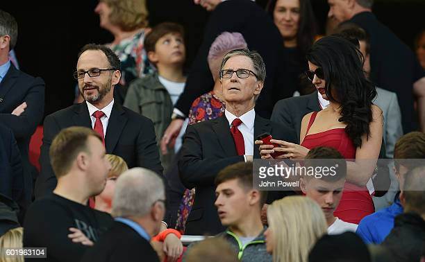 John W Henry president of Liverpool Linda Pizzuti Henry and Mike Gordon during the Premier League match between Liverpool and Leicester City at...
