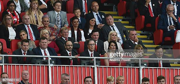 John W Henry president of Liverpool Linda Pizzuti Henry and Mike Gordon Tom Werner during the Premier League match between Liverpool and Leicester...