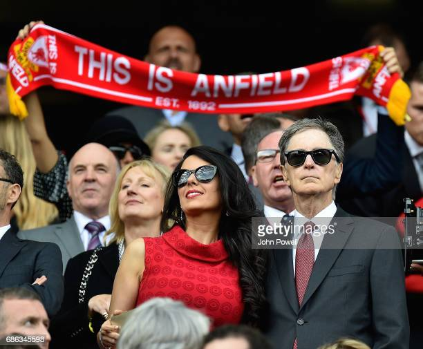 John W Henry principal owner of Liverpool and his wife Linda Pizzuti watch from the directors box before the Premier League match between Liverpool...