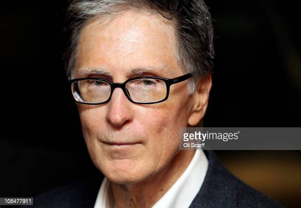 John W. Henry, the owner of New England Sports Ventures, delivers a statement in the offices of the law firm Slaughter and May to announce his...