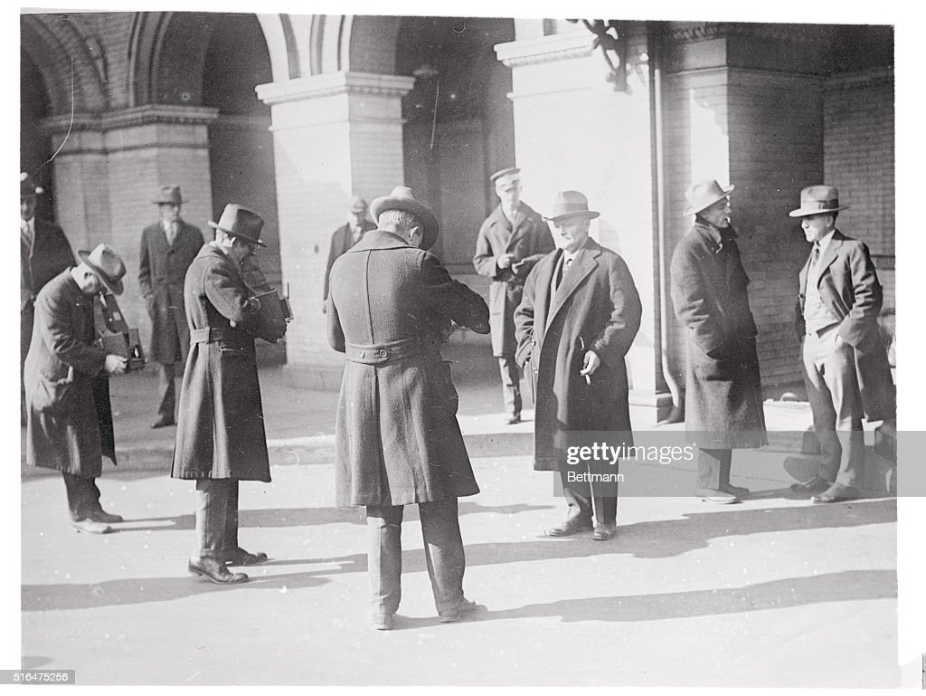 John W. Langley With Others on Courthouse Steps : News Photo