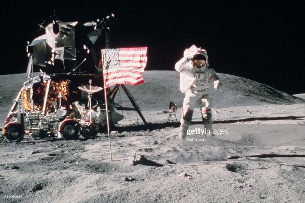 John W. Young, Commader of Apollo 16, salutes the United States Flag as he leaps from the surface of the Moon near the lunar lander. | Location: Descartes landing site, The Moon.