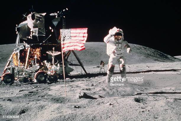 John W Young Commader of Apollo 16 salutes the United States Flag as he leaps from the surface of the Moon near the lunar lander | Location Descartes...