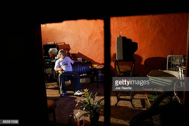 John Wade a resident of the French Quarter watches television powered by a generator as US President George W Bush delivers his speech to the nation...