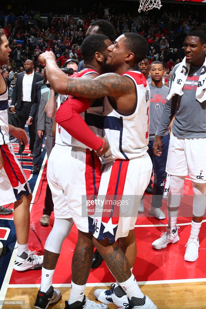 John Wall #2 and Bradley Beal #3 of the Washington Wizards celebrate after the game against the Orlando Magic on March 5, 2017 at Verizon Center in Washington, DC.