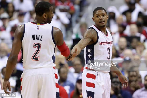 John Wall and Bradley Beal of the Washington Wizards celebrate after Beal scored and was fouled against the Atlanta Hawks in the second half of Game...
