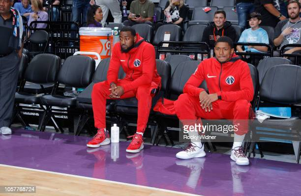 John Wall and Bradley Beal of the Washington Wizards look on during the game against the Sacramento Kings on October 26 2018 at Golden 1 Center in...