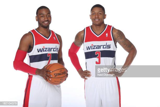 John Wall and Bradley Beal of the Washington Wizards pose for a portrait during 2013 NBA Media Day at the Verizon Center on September 27 2013 in...