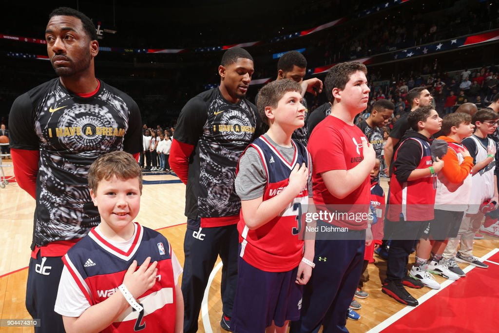 John Wall #2 and Bradley Beal #3 of the Washington Wizards stand on the court for the National Anthem before the game against the Orlando Magic on January 12, 2018 at Capital One Arena in Washington, DC.