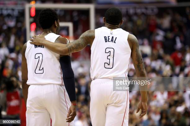 John Wall and Bradley Beal of the Washington Wizards talk on the floor in the first half against the Toronto Raptors during Game Four of Round One of...