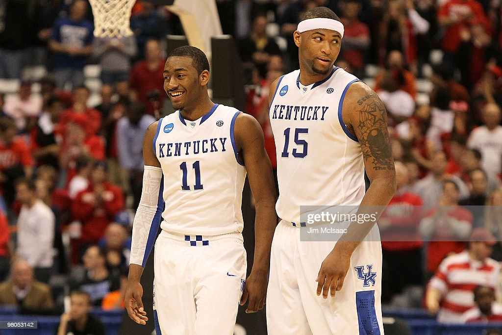 John Wall #11 and DeMarcus Cousins #15 of the Kentucky Wildcats react late in the second half against the Cornell Big Red during the east regional semifinal of the 2010 NCAA men's basketball tournament at the Carrier Dome on March 25, 2010 in Syracuse, New York.