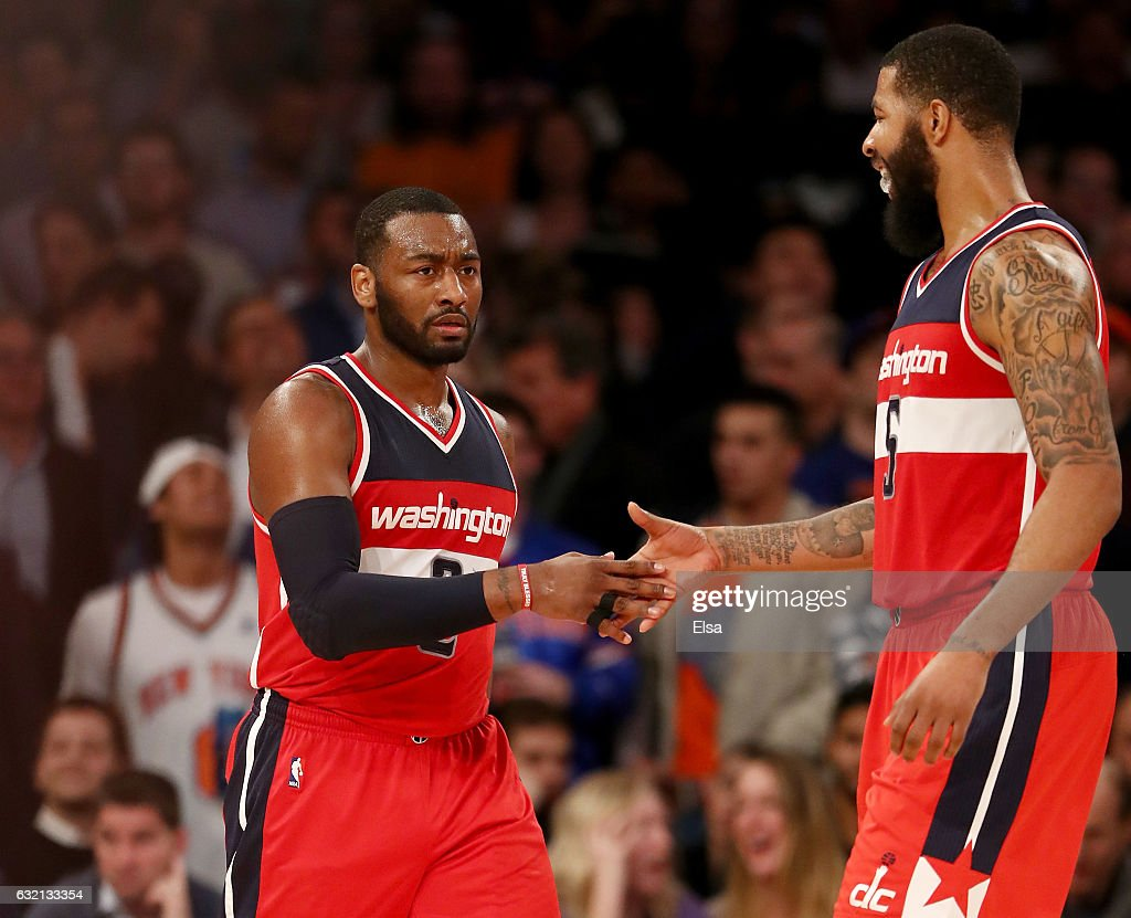 John Wall #2 and Markieff Morris #5 of the Washington Wizards celebrate the win over the New York Knicks at Madison Square Garden on January 19, 2017 in New York City.