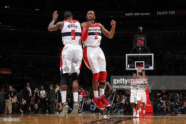 John Wall and Martell Webster of the Washington Wizards celebrate a made basket against the Brooklyn Nets during the game at the Verizon Center on...