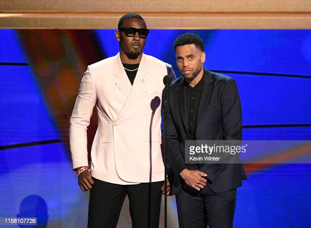 John Wall and Michael Ealy speak onstage during the 2019 NBA Awards presented by Kia on TNT at Barker Hangar on June 24, 2019 in Santa Monica,...
