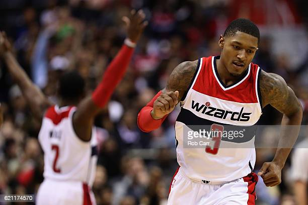 John Wall celebrates after Bradley Beal of the Washington Wizards hit a three point shot against the Atlanta Hawks in the fourth quarter of the...