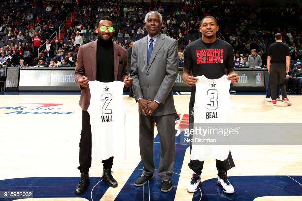 John Wall Former Player Bob Dandridge and Bradley Beal of the Washington Wizards pose for a picture before the game against the Boston Celtics on...