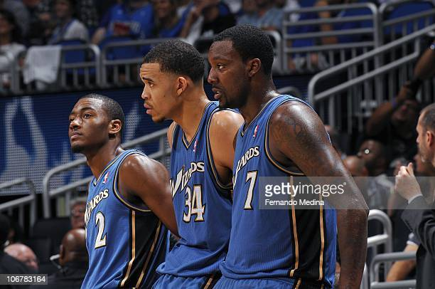 John Wall JaVale McGee and Andray Blatche of the Washington Wizards stand on the sideline during a game against the Orlando Magic on October 28 2010...