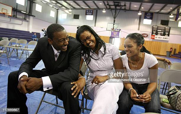 John Wall laughs with his sisters Tonya Pulley center and Cierra Wall right after a press conference at Word of God Christian Academy on Wednesday...