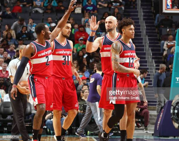 John Wall Marcin Gortat Tomas Satoransky and Kelly Oubre Jr #12 of the Washington Wizards are seen during the game against the Charlotte Hornets on...