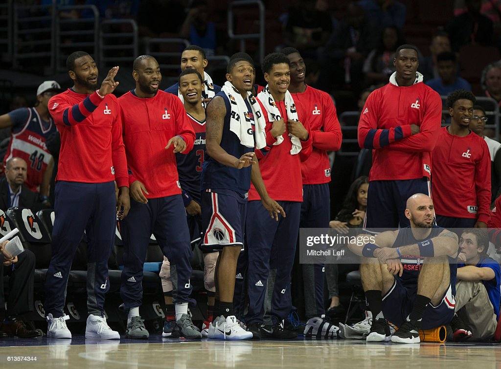 John Wall #2, Marcus Thornton #15, Bradley Beal #3, Otto Porter Jr. #22, Andrew Nicholson #44, Jarell Eddie #8, and Trey Burke #33 of the Washington Wizards react during the game against the Philadelphia 76ers at Wells Fargo Center on October 6, 2016 in Philadelphia, Pennsylvania. The Wizards defeated the 76ers 125-119 in double overtime.