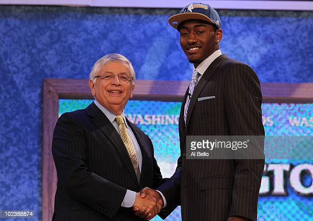 John Wall of Kentucky stands with NBA Commisioner David Stern after being drafted with the first pick by the Washington Wizards at Madison Square...