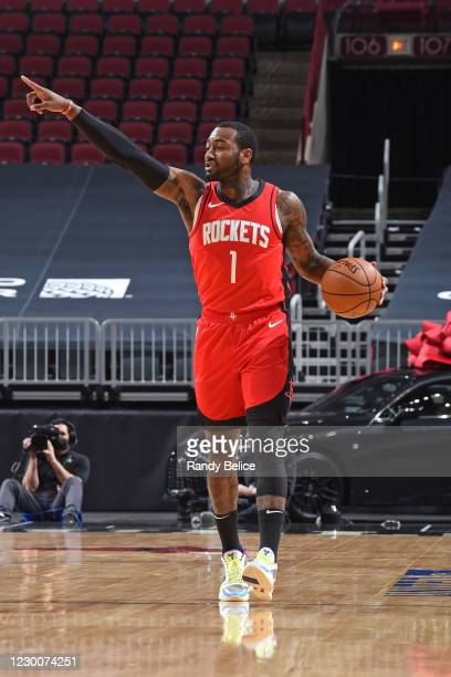 John Wall of the Houston Rockets dribbles the ball and calls a play against the Chicago Bulls during a preseason game at the United Center on...