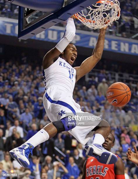 John Wall of the Kentucky Wilcats dunks the ball during the SEC game against the Ole Miss Rebels on February 2, 2010 at Rupp Arena in Lexington,...