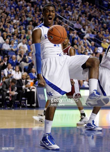 John Wall of the Kentucky Wildcats celebrates after dunking the ball during the game against the Rider Broncs on November 21, 2009 at Rupp Arena in...