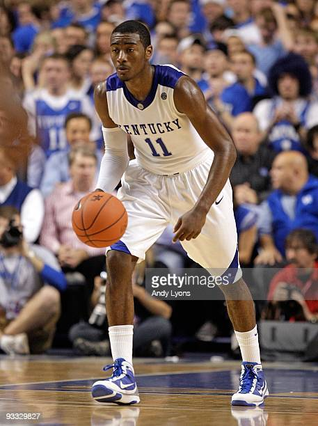 John Wall of the Kentucky Wildcats dribbles the ball during the game against the Miami University Redhawks at Rupp Arena on November 16 2009 in...