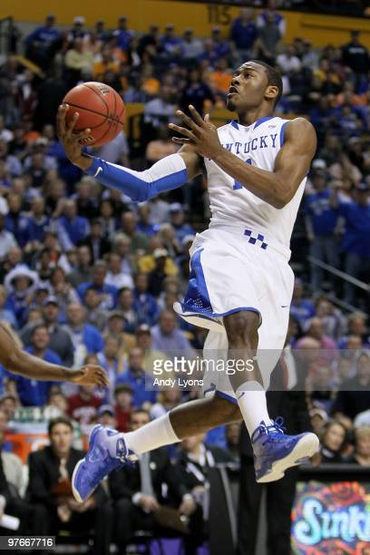 John Wall of the Kentucky Wildcats drives for a shot attempt against the Alabama Crimson Tide during the quarterfinals of the SEC Men's Basketball...