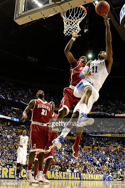 John Wall of the Kentucky Wildcats drives for a shot attempt against Tony Mitchell of the Alabama Crimson Tide during the quarterfinals of the SEC...